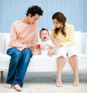 Parents with a crying baby